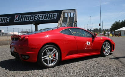 A side view of a red 2006 Ferrari F430 Coupe at the Ferrari Challenge Rally