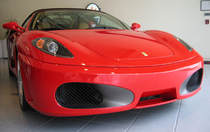 A front view of a red 2006 Ferrari F430 Spider
