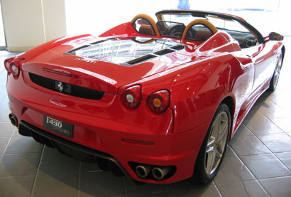 A three-quarter rear view of a red 2006 Ferrari F430 Spider