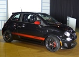 A three-quarter front view of a black 2012 Fiat 500 Abarth