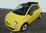 A three-quarter front view of a yellow 2012 Fiat 500 Cabrio