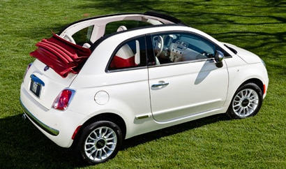 A three-quarter rear view of a white 2012 Fiat 500 Cabrio