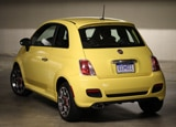 A three-quarter rear view of a yellow 2012 Fiat 500 Sport