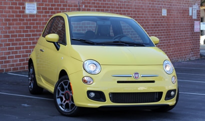 A three-quarter front view of a yellow 2012 Fiat 500 Sport