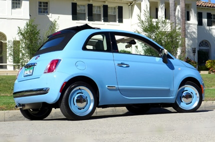 A three-quarter rear view of the 2015 Fiat 500C 1957 Edition in Celeste Blu