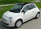A three-quarter front view of a white 2012 Fiat 500c by Gucci