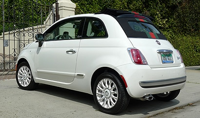 A three-quarter rear view of a white 2012 Fiat 500c by Gucci