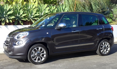 A three-quarter front view of a 2014 Fiat 500L