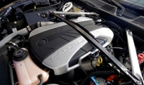 The 2.0-liter turbocharged inline 4-cylinder engine of the Fisker Karma is supplemented by two electric motors
