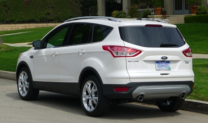A three-quarter rear view of a 2013 Ford Escape Titanium FWD