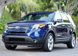 A three-quarter front view of a blue 2011 Ford Explorer, one of our Top 10 SUVs