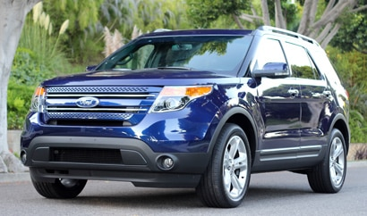 A three-quarter front view of a blue 2011 Ford Explorer