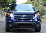 A front view of a blue 2011 Ford Explorer