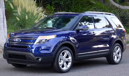 A three-quarter front view of a blue 2011 Ford Explorer Limited