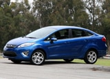 A side view of a blue 2011 Ford Fiesta Sedan