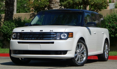 A three-quarter front view of a white 2011 Ford Flex Titanium