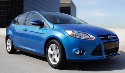 A three-quarter front view of a blue 2012 Ford Focus