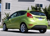 A three-quarter rear view of a green 2010 Ford Fiesta Hatchback
