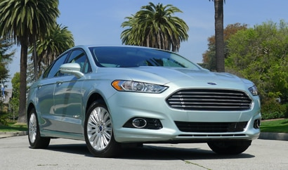 A three-quarter front view of a 2013 Ford Fusion Hybrid SE