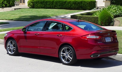A three-quarter rear view of a 2013 Ford Fusion Titanium