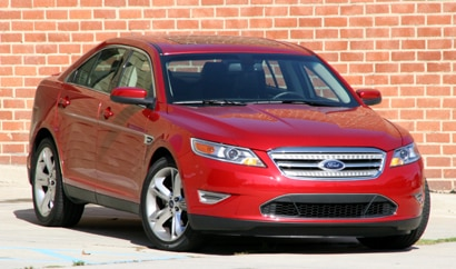 A three-quarter front view of a red 2010 Ford Taurus SHO AWD