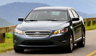 A three-quarter front view of a 2010 Ford Taurus