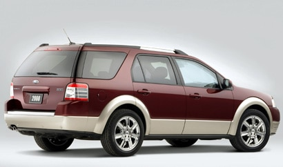 A three-quarter rear view of a maroon 2008 Ford Taurus X AWD Eddie Bauer