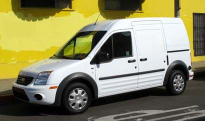 A three-quarter front view of a 2010 Ford Transit Connect XLT