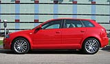 A side view of a red Audi A3