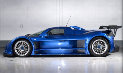 A side view of a blue Gumpert Apollo, one of the fastest cars in the world