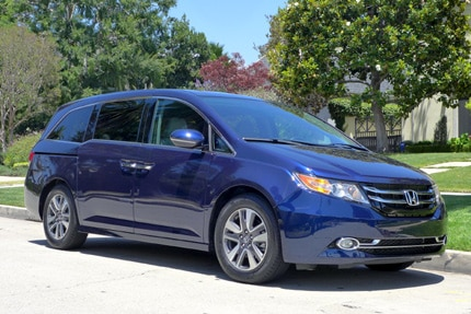 A three-quarter front view of the 2015 Honda Odyssey 5-Door Touring Elite