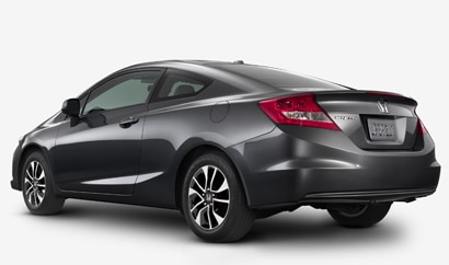 A three-quarter rear view of a 2013 Honda Civic Coupe