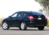 A three-quarter rear view of a black 2010 Honda Accord Crosstour