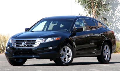 A three-quarter front view of a black 2010 Honda Accord Crosstour