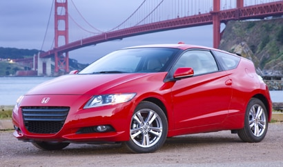 A three-quarter rear view of a red 2011 Honda CR-Z
