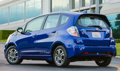 A three-quarter rear view of a 2013 Honda Fit EV