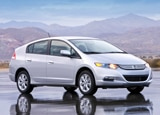 A three-quarter front view of a silver 2010 Honda Insight