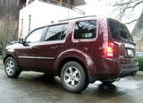 A three-quarter rear view of a 2009 Honda Pilot Touring