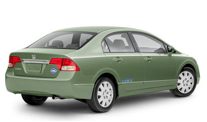 A three-quarter rear view of a green 2009 Honda Civic GX