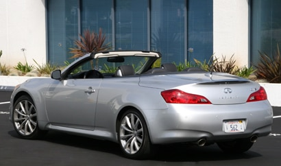 A three-quarter rear view of a silver 2010 Infiniti G37 convertible
