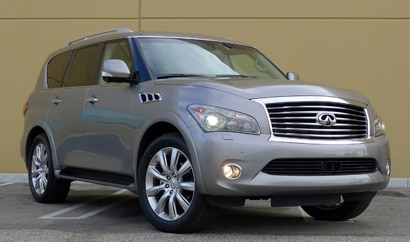 A three-quarter front view of a silver 2012 Infiniti QX56 4WD