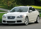A three-quarter front view of a white 2010 Jaguar XFR