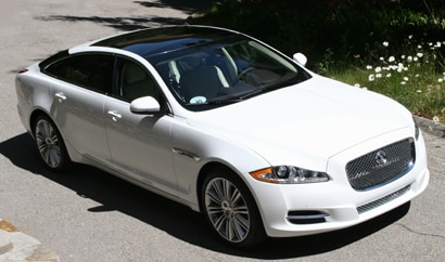 A three-quarter front view of a white 2011 Jaguar XJL