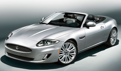 A three-quarter front view of a silver 2012 Jaguar XK Convertible