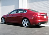 A three-quarter rear view of a red 2009 Jaguar XF Supercharged