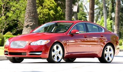 A three-quarter front view of a red 2009 Jaguar XF Supercharged