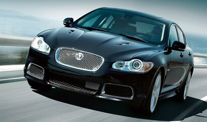 A three-quarter front view of a black 2010 Jaguar XFR