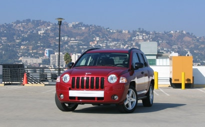 A front view of a red 2007 Jeep Compass Limited 4x4