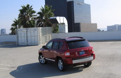 A three-quarter rear view of a red 2007 Jeep Compass Limited 4x4