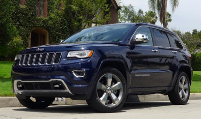 A three-quarter front view of the 2014 Jeep Grand Cherokee, one of our Top 10 SUVs